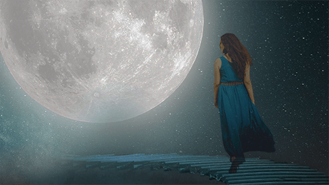 Woman in blue on a stairway to a large moon